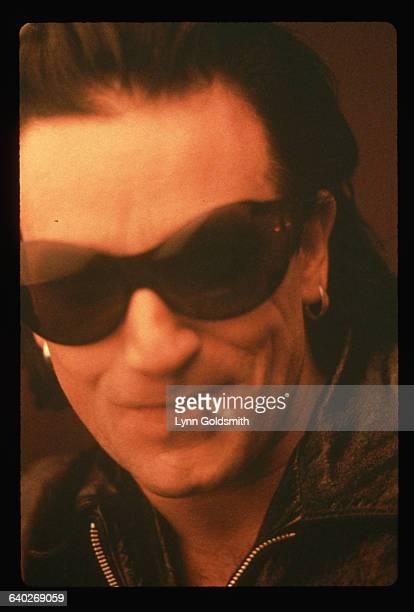 Bono singer for the rock group U2 smokes a cigarette