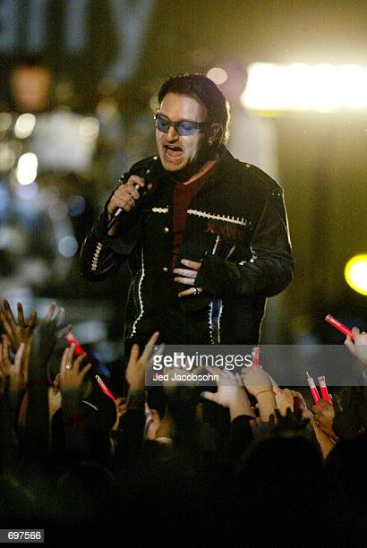 Bono singer of music group U2 performs during halftime of Super Bowl XXXVI February 3 2002 at the Superdome in New Orleans LA Super Bowl XXXVI is...