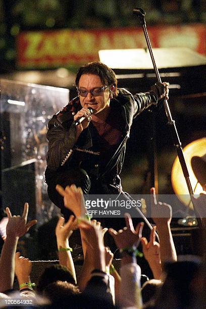 Bono singer with the Irish rock group U2 performs during halftime 03 February 2002 of Super Bowl XXXVI in New Orleans Louisiana The St Louis Rams and...