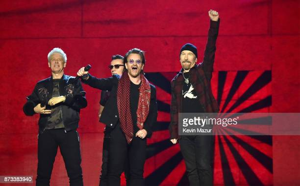 U2 Bono The Edge Adam Clayton and Larry Mullen Jr accept the global icon award on stage during the MTV EMAs 2017 held at The SSE Arena Wembley on...