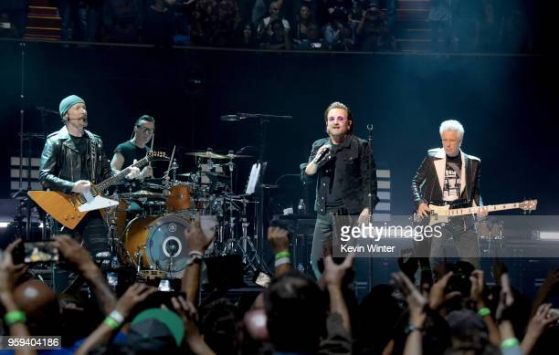 Bono The Edge Adam Clayton and Larry Mullen Jr of U2 perform at The Forum on May 16 2018 in Inglewood California