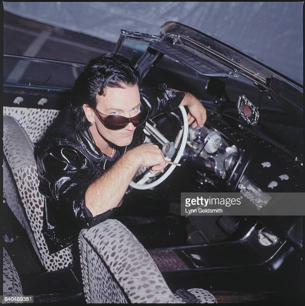 Bono the lead singer of musical group U2 poses with a cigarette in hand