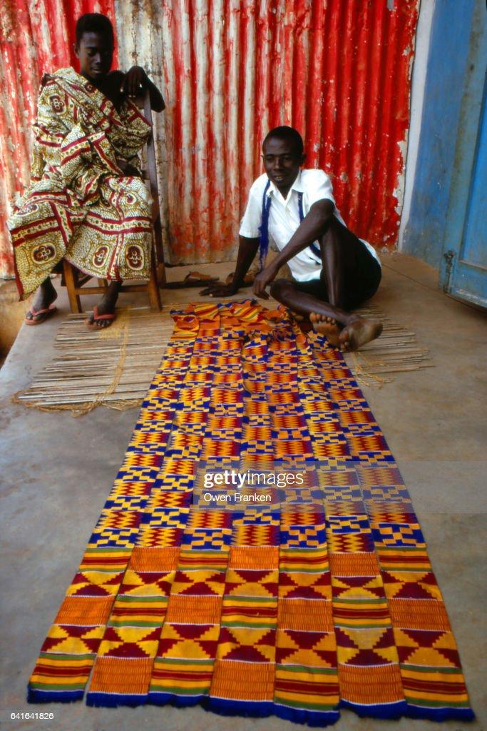 Bonwire, Ghana - two kente cloth weavers : Stock Photo