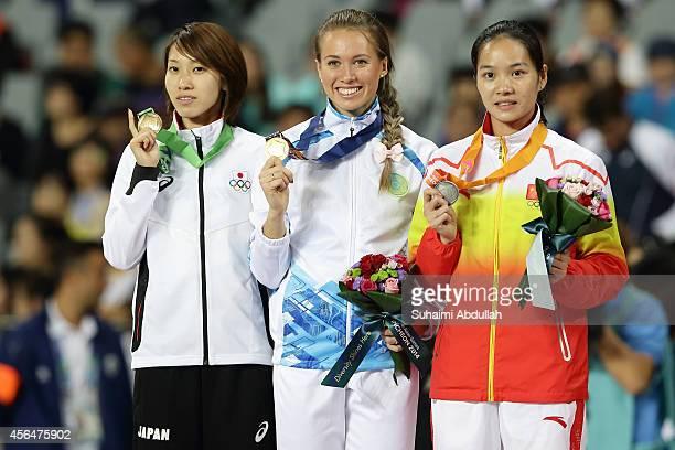 Bonze medallist Chisato Fukushima of Japan gold medallist Olga Safronova of Kazakhstan and silver medallist Wei Yongli of China celebrates on the...