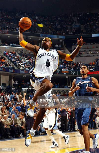 Bonzi Wells of the Memphis Grizzlies goes up for a dunk during a game against the Washington Wizards on Novemeber 3, 2004 at Fedex Forum in Memphis,...