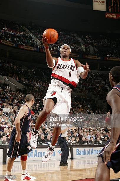 Bonzi Wells of the Portland Trail Blazers goes up against the New Jersey Nets on November 28 2003 at the Rose Garden Arena in Portland Oregon NOTE TO...
