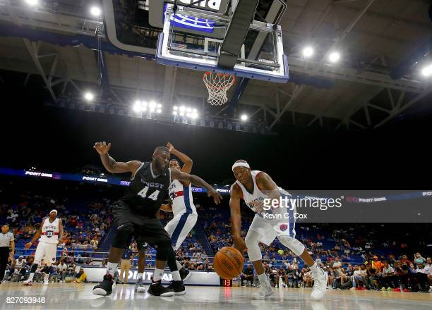 Bonzi Wells of TriState and Ivan Johnson of the Ghost Ballers dive for a rebound during week seven of the BIG3 three on three basketball league at...