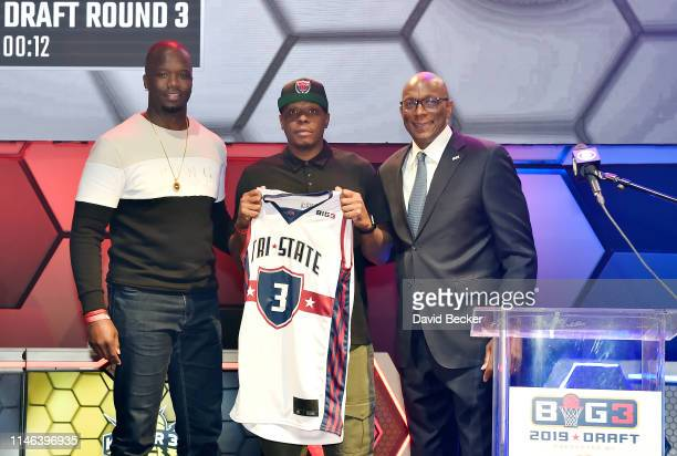 Bonzi Wells poses with TriState captain Jermaine O'Neal and BIG3 Commissioner Clyde Drexler after being drafted at by the TriState in the third round...