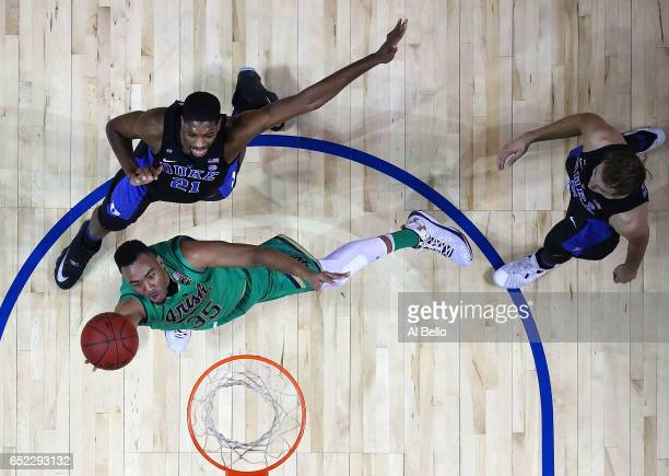 Bonzie Colson of the Notre Dame Fighting Irish attacks the basket against Amile Jefferson and Luke Kennard of the Duke Blue Devils during the...