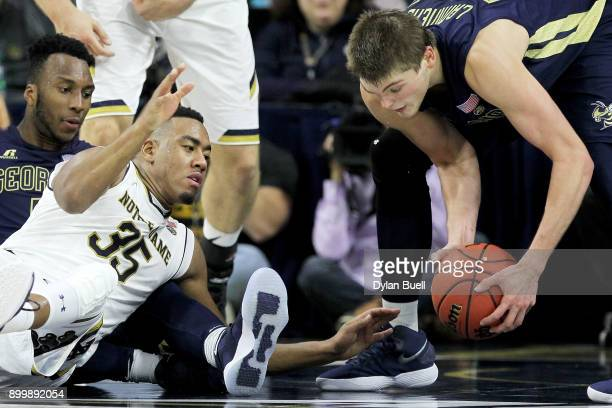 Bonzie Colson of the Notre Dame Fighting Irish battles for a loose ball against Josh Okogie and Ben Lammers of the Georgia Tech Yellow Jackets in the...