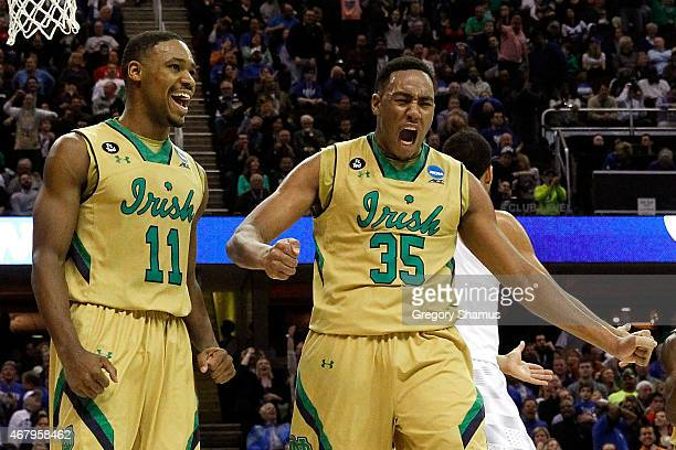 Bonzie Colson of the Notre Dame Fighting Irish celebrates with Demetrius Jackson after a play in the first half against the Kentucky Wildcats during...