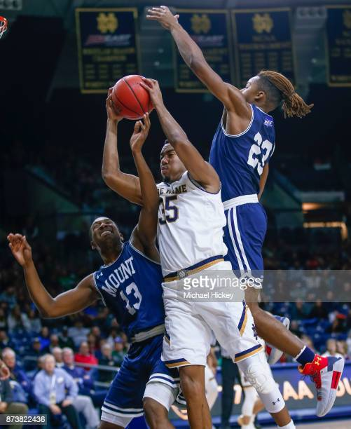 Bonzie Colson of the Notre Dame Fighting Irish tries to go up for a shot as Omar Habwe and Greg Alexander of the Mount St Mary's Mountaineers defend...