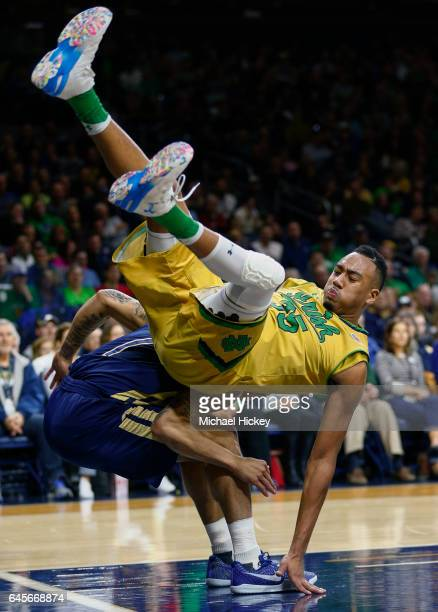 Bonzie Colson of the Notre Dame Fighting Irish tumbles with Tadric Jackson of the Georgia Tech Yellow Jackets at Purcell Pavilion on February 26 2017...