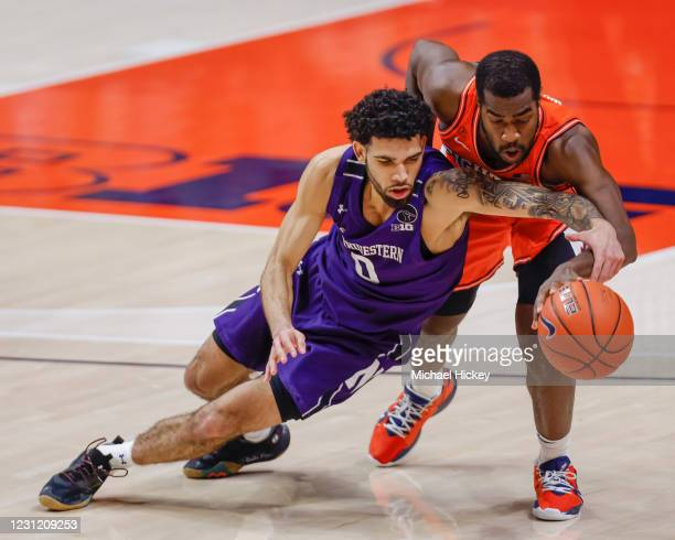 Boo Buie of the Northwestern Wildcats and Da'Monte Williams of the Illinois Fighting Illini scramble for the loose ball during the second half at...