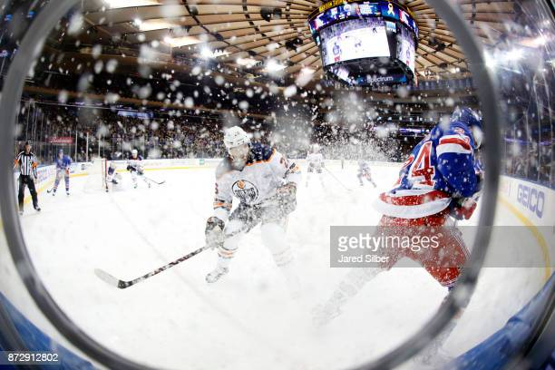 Boo Nieves of the New York Rangers skates against Iiro Pakarinen of the Edmonton Oilers as snow flies at Madison Square Garden on November 11 2017 in...