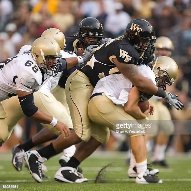 Boo Robinson of the Wake Forest Demon Deacons sacks quarterback Jarod Bryant of the Navy Midshipmen during second half action on September 27 2008 at...