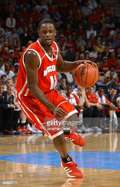 Boo Wade of the University of Wisconsin Madison Badgers drives against the University of Pittsburgh Panthers during the second round game of the NCAA...