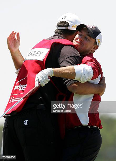 Boo Weekley hugs his caddie as he reacts to chipping in for a par on the 18th green during the final round of the Verizon Heritage on April 16 2007...