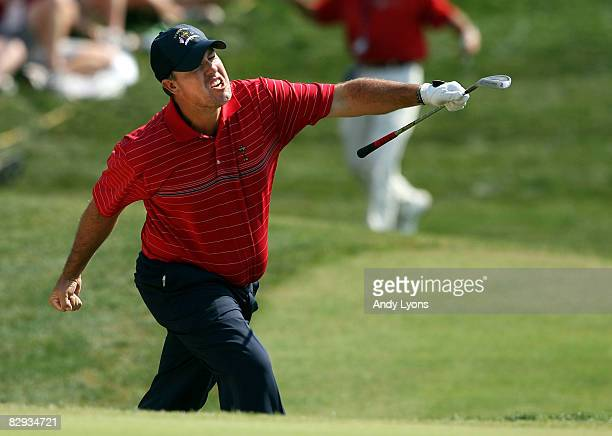 Boo Weekley of the USA team celebrates making bridie out of the bunker on the seventh hole during the singles matches on the final day of the 2008...