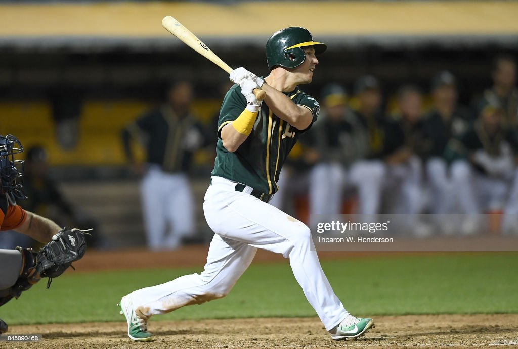 Boog Powell #3 of the Oakland Athletics hits a bases load two-run rbi single against the Houston Astros in the bottom of the eighth inning of the second game in a double header at Oakland Alameda Coliseum on September 9, 2017 in Oakland, California.