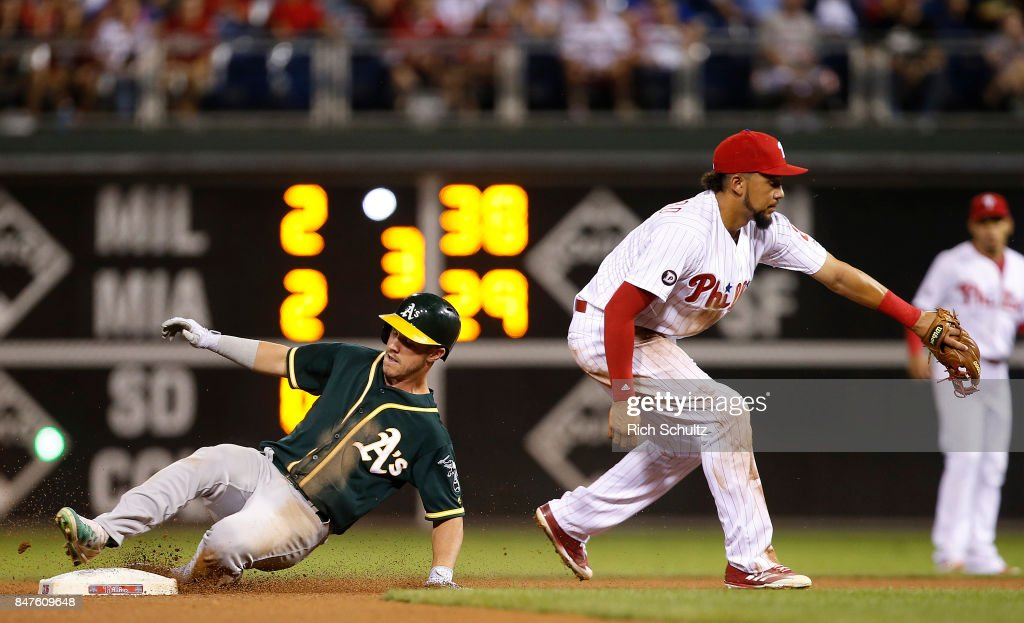 Boog Powell #3 of the Oakland Athletics slides into second base with a double during the seventh inning as J.P. Crawford #2 of the Philadelphia Phillies fields the throw during a game at Citizens Bank Park on September 15, 2017 in Philadelphia, Pennsylvania.The A's defeated the Phillies 4-0,