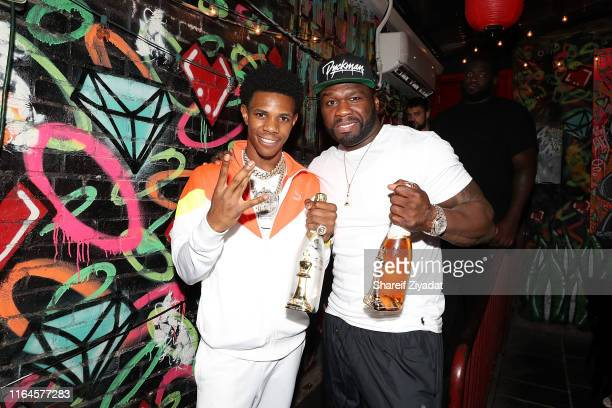 Boogie Wit Da Hoodie and 50 Cent attends A Boogie Wit Da Hoodie 200 Million Streams on AudioMack Celebration Dinner on August 28 2019 in New York City