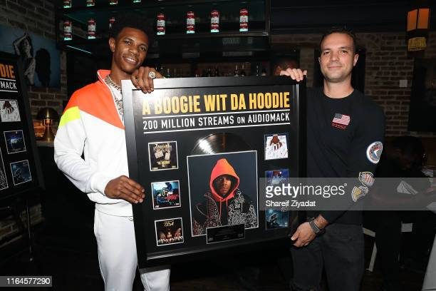 Boogie Wit Da Hoodie and David Ponte attend A Boogie Wit Da Hoodie 200 Million Streams on AudioMack Celebration Dinner on August 28 2019 in New York...