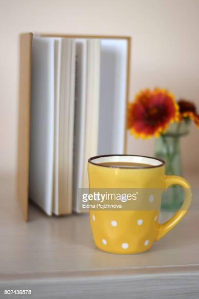 book and a coffee - elena blume stock-fotos und bilder