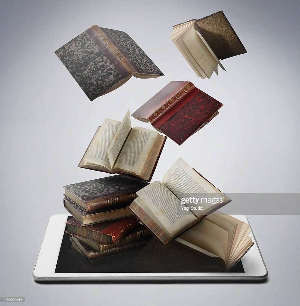 Book and digital tablet : Stock Photo