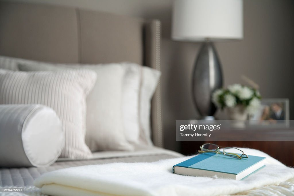 Book and glasses on a shawl : Stockfoto