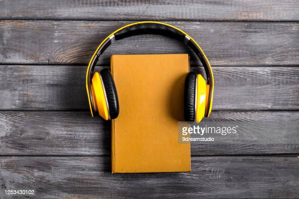 book yellow headphones on background top