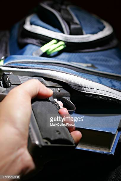 book bag and a handgun - concealed carry stock photos and pictures