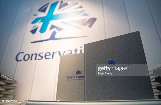 A book by former Prime Minister David Cameron is displayed alongside party merchandise being offered for sale at the 2016 Conservative Party...