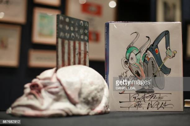 A book by Gerald Scarfe entitled 'The Making of Pink Floyd The Wall' with two illustrations added to dustjacket by Gerald Scarfe is seen during a...