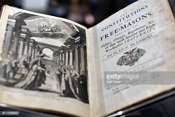 A book by James Anderson titled 'The Constitutions of the FreeMasons' dated 1723 is displayed by a member of staff during a press preview for the...