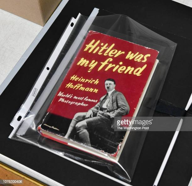 A book by photographer Heinrich Hoffmann was part of the lot that sold with a Hoffmann photograph of Adolf Hitler pictured with a young girl of...