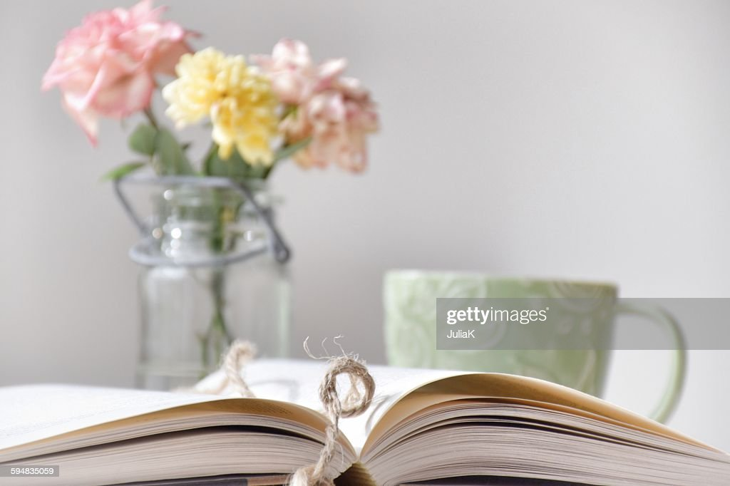 Book, coffee and flowers : Stock Photo