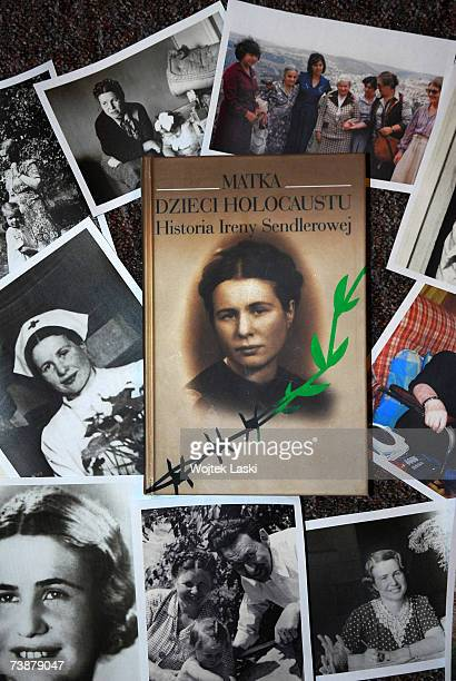 A book cover and photographs are displayed at a reception at which Polish children presented Irena Sendlerowa with the Order of Smiles at Bonifraters...