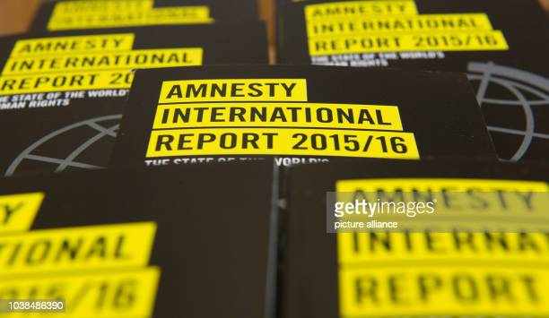 Book covers read 'Amnesty International Report 2015/16' at the presentation of the annual report on the global human rights situation in Berlin...
