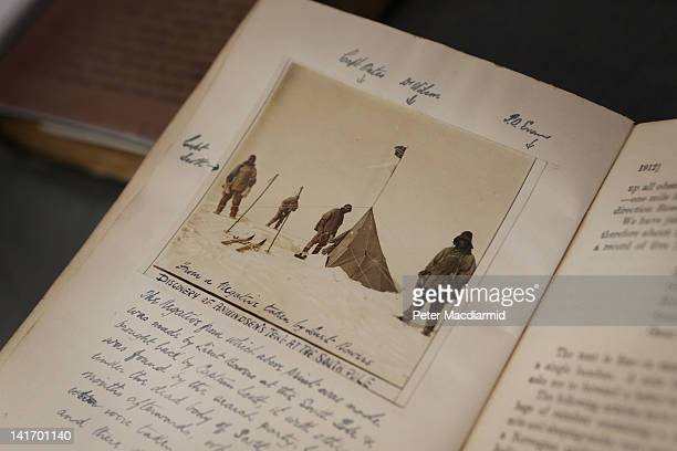 Book entitled 'Scott's Last Expedition' shows a photograph of Captain Robert Falcon Scott's team finding Amundsen's tent at the South Pole, at...