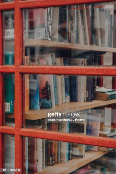 book exchange inside red phone box in combe st nicholas, somerset, uk. - taunton somerset stock pictures, royalty-free photos & images