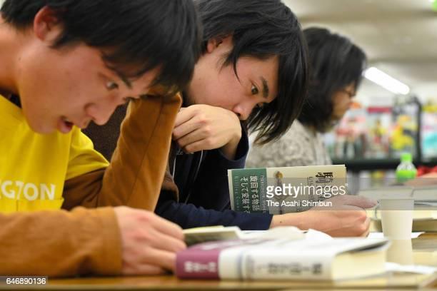 Book fans read after Haruki Murakami's 'Kishidancho Goroshi' a twovolume work going on sale on February 24 2017 in Tokyo Japan