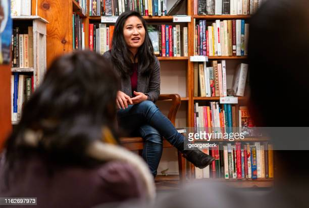 book group meeting at a bookstore - authors stock pictures, royalty-free photos & images