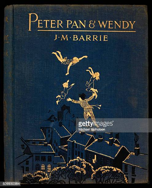 Book illustrated by Gwynedd M Hudson Illustration shows Peter Pan Wendy John and Michael flying above rooftops of houses of an English town