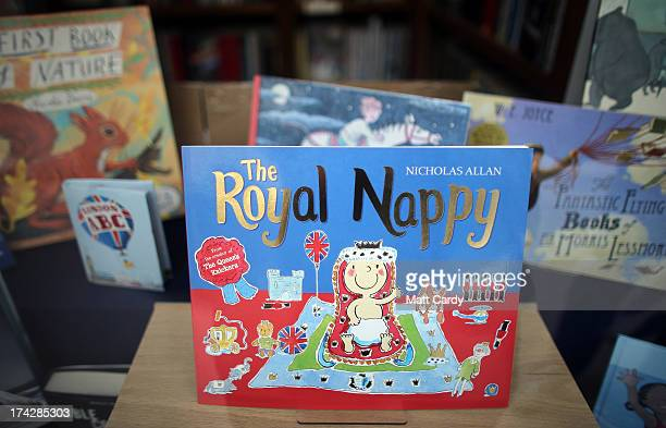 A book is displayed in a shop to celebrate the Royal birth on July 23 2013 in Tetbury England Catherine Duchess of Cambridge yesterday gave birth to...