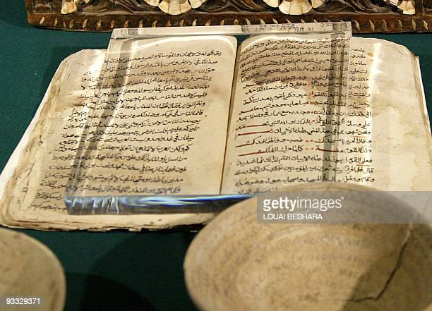 A book is put on display one of the 700 Iraqi antiquities which have been in the care of Syria authorities at the National Syrian Museum in Damascus...