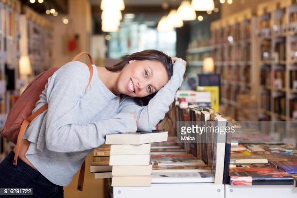 book lover at a book store - book store stock photos and pictures