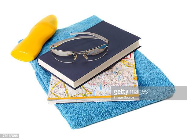 Book map and beach towel
