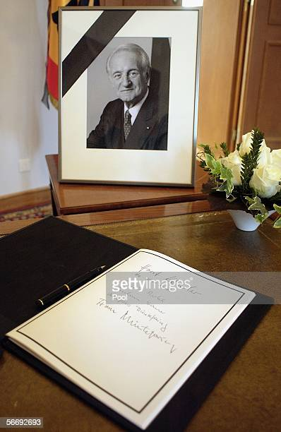A book of condolence for the deceased former German President Johannes Rau and his portrait are seen at Bellevue Palace Germany's presidential palace...