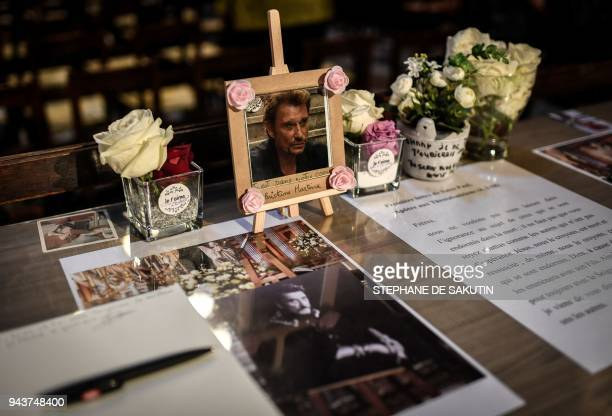 A book of condolence is displayed during a ceremony in tribute to the late French Rock'n Roll star Johnny Hallyday on April 9 2018 at La Madeleine...